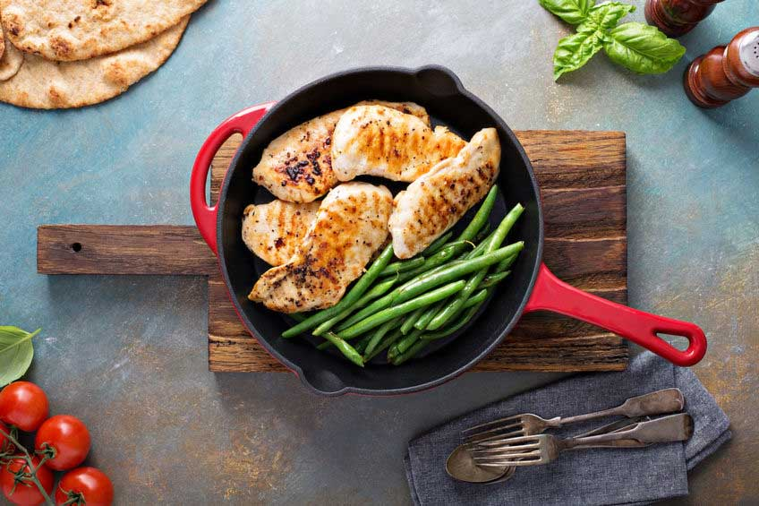 Potatoes, Green Beans and Chicken in a cast iron skillet