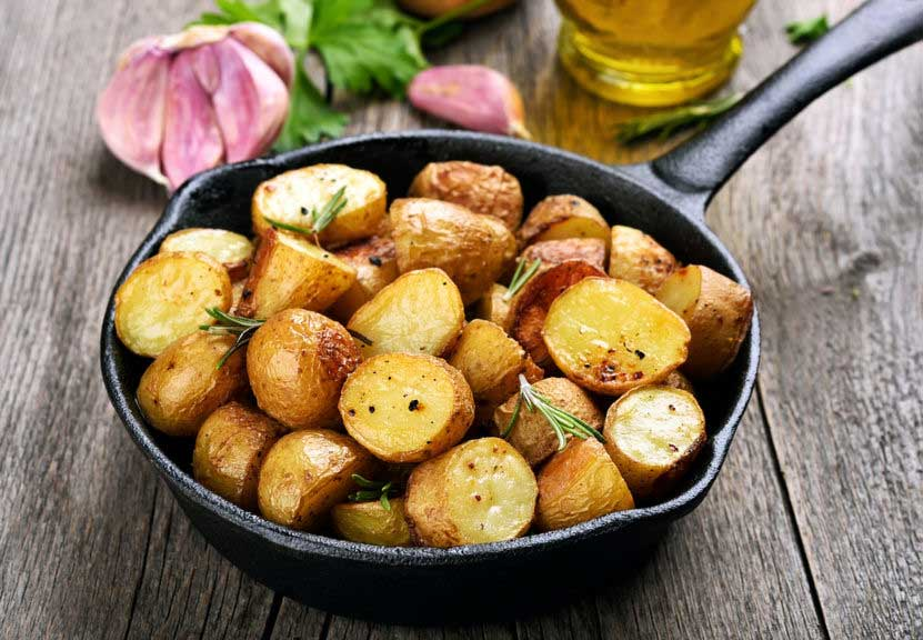 Roasted rosemary potatoes in a cast iron skillet